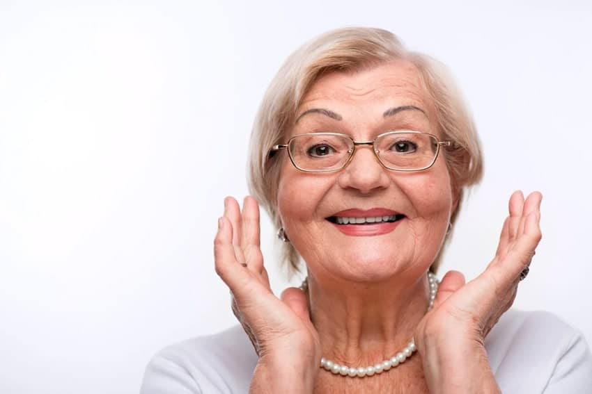 happy elderly woman outlining her smile