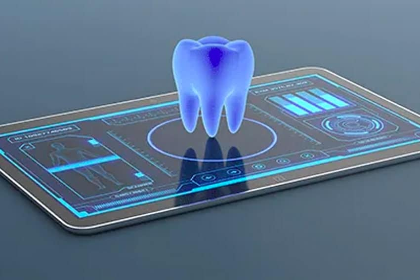 a 3-D hologram of a tooth sitting over a iPAD electronic tablet