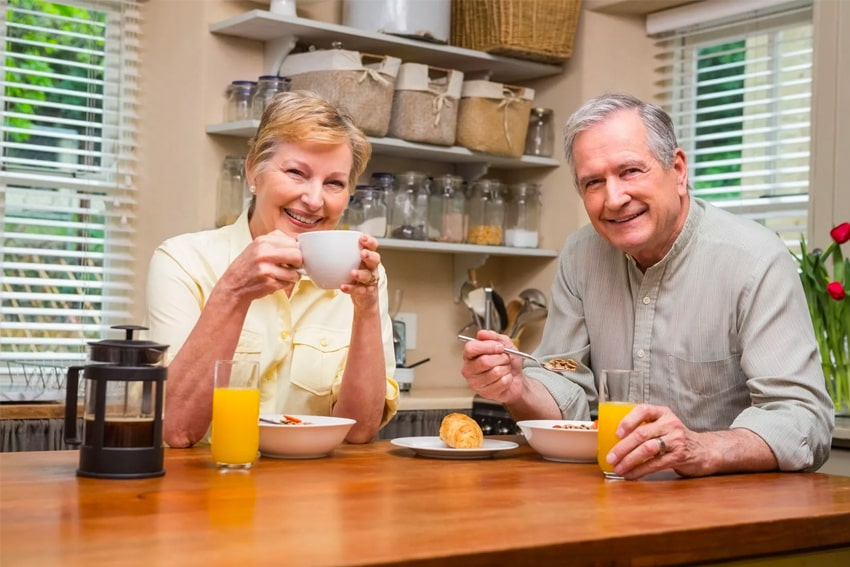 Mature couple enjoys breakfast together