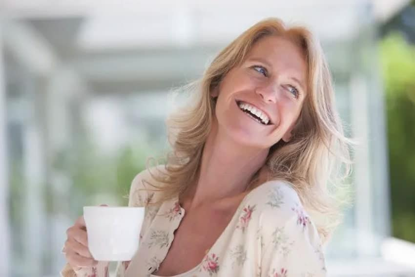 Happy woman enjoying her coffee