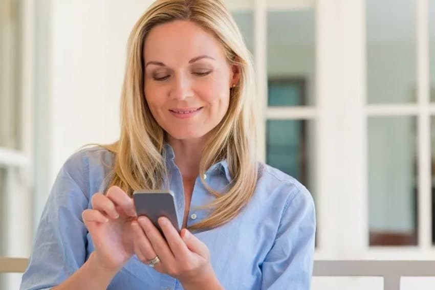 Mature woman checking her phone