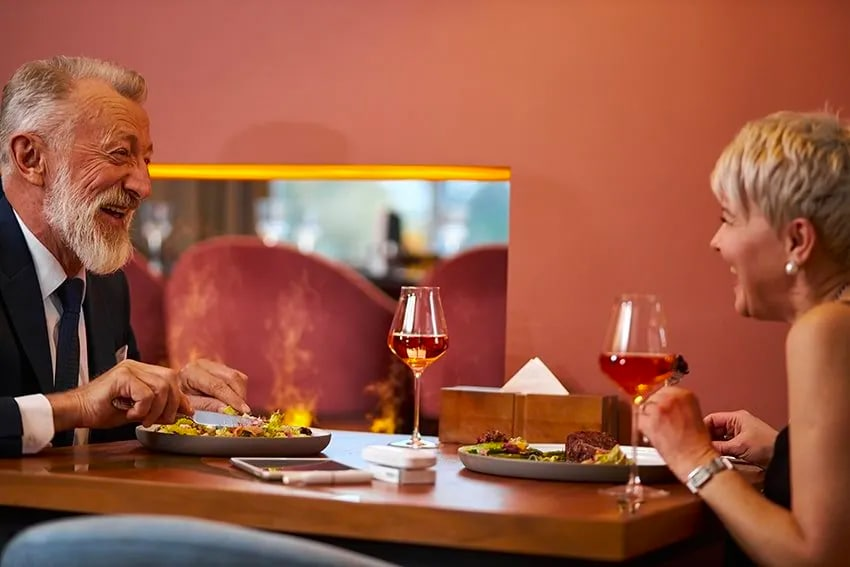 senior couple enjoying a meal together