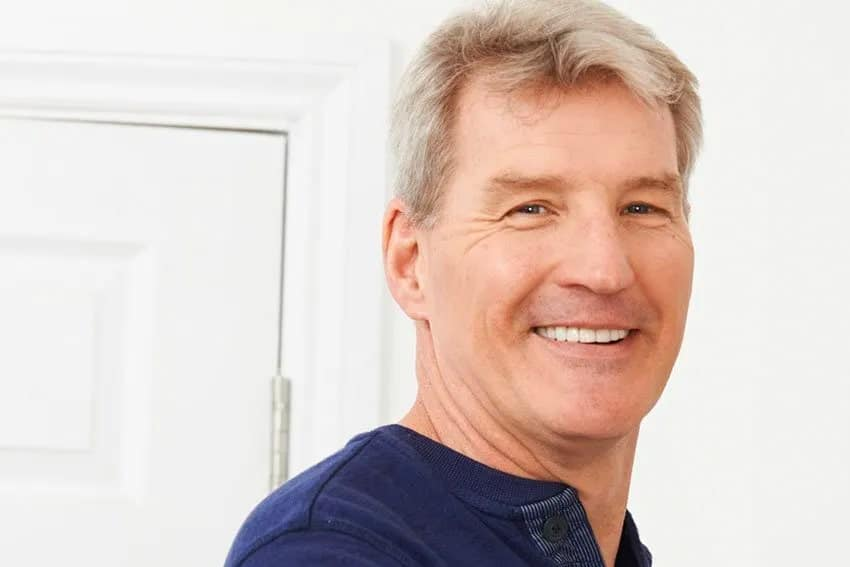 Mature man smiling at home