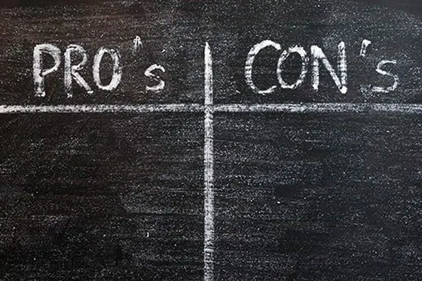 A set of pros and cons list on a chalkboard