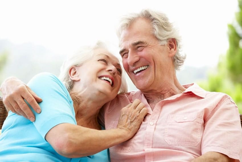 Older couple enjoying each other company and laughing