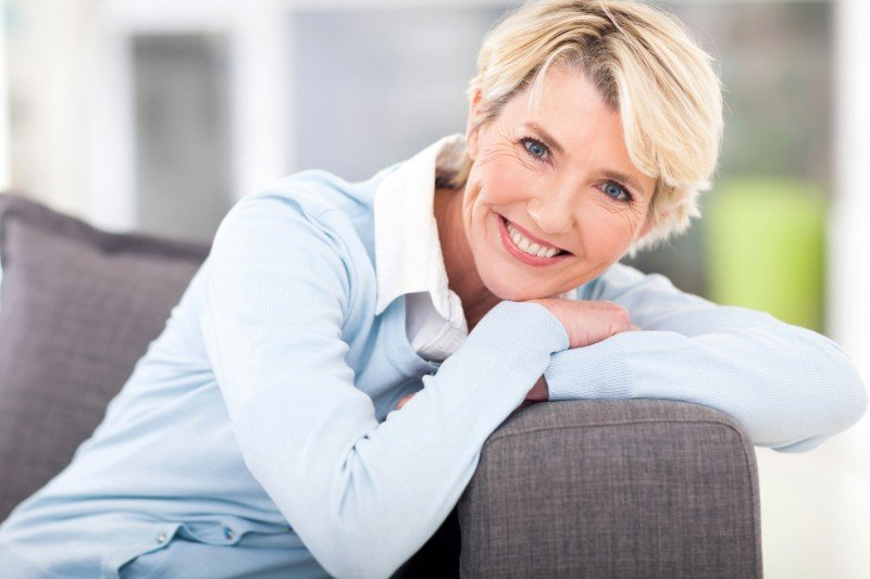 Smiling Woman With Single Arch Dentures