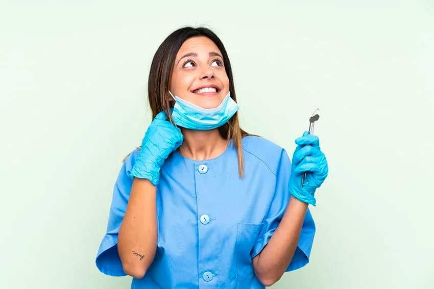 woman dentist looking up in the sky, smiling