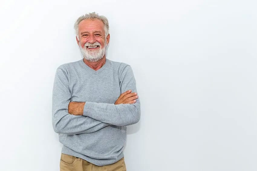Senior man crossing his arms, smilng