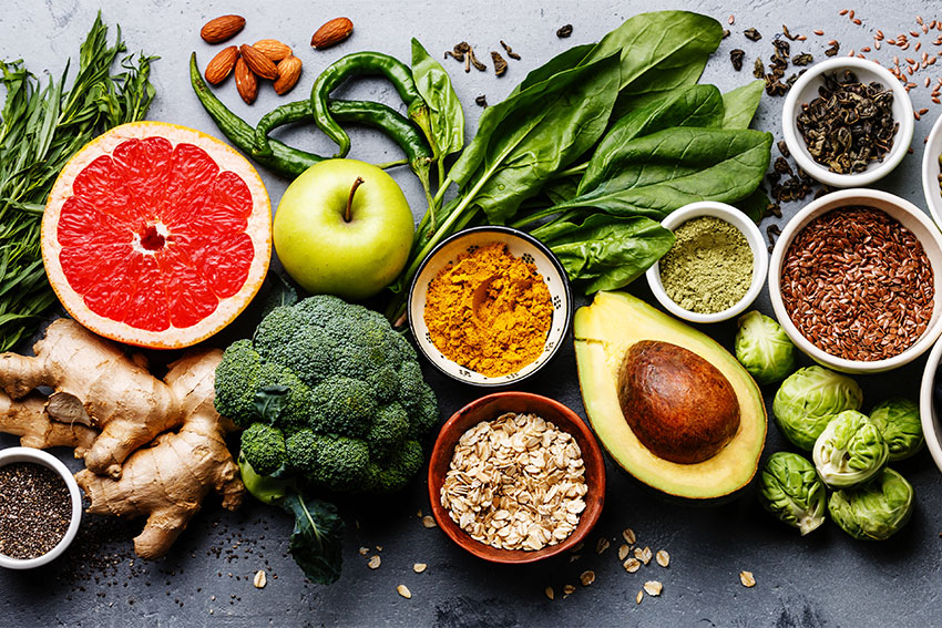selection of healthy food; grapefruit, avocados and grains
